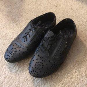 Black cut out shoes